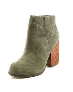 Distressed suede booties with a zip closure and elastic gusset at the inner side. Stacked suede heel and rubber sole. Leather: Cowhide. Imported. This item cannot be gift-boxed. MEASUREMENTS Heel: 3.5
