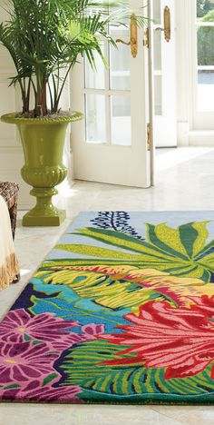 Inspired by tropical foliage and flowers, our beautifully bright and sculpted area rug is sure to anchor your room and transform your space.