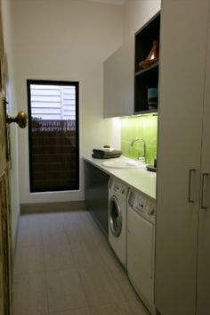 bench with built-in sink and washer/dryer under