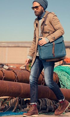 Beat the winter in Brown Trenchcoat, White Black Striped Sweater, Navy Denim Shirt, Blue Leatger Messenger Bag, Navy Jeans and a pair of Brown Leather Boots