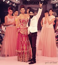 AD Singh along with bollywood actress Karishma Tanna for Blenders pride punjab international fashion week. The collection was dominated by fluid gowns with deep backs and bridal lehengas in red, with intricate zardosi embroidery and swarovski crystals.