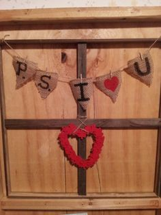 Handmade wood frame with burlap strung with twine and letters painted on. The heart is made out of puzzle pieces and painted!