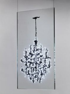 Luster by Ingo Maurer is a chandelier made of sheets of glass imprinted with the sketch of a chandelier and lit by 270 white embedded LEDs by Pinky and the Brain