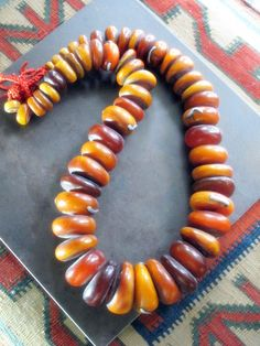 *|* Large Berber Amber (Resin Amber) Graduated Beads from The Atlas Mountain region of Northern Algeria. Some with traditional Silver Metal Tribal Jewelry braces