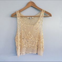 Forever 21 Gold Sequin Tank Top  NWOT Never worn, beautiful gold sequined tank top. The fit is a crop top and it is sheer, so a bandeau or camisole underneath is basically a necessity (unless you're into that #FreeTheNips). it's a large, and true to size. Forever 21 Tops Tank Tops