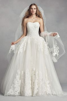 70f6bb2d3543 Arched lace appliques, inspired by the architectural motifs, give this  cathedral-length White by Vera Wang veil a sense of grandeur. White by Vera  Wang, ...