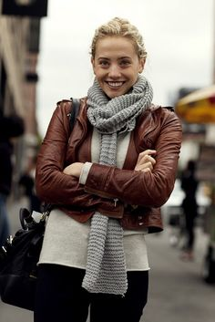 Grey scarf and leather jacket.