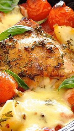 Italian Baked Chicken with Potatoes and Cherry Tomatoes Recipe ~ super tasty... Chicken, potatoes and tomato drizzled with an Italian Dressing and baked until golden, topped with gooey melted cheese. 15 minutes of prep, then just pop it into the oven!