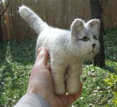 White Cat by Klara: Hand sculpted of felted wool for a soft and natural feeling. Made in Hungary $115.