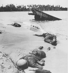 George Strock, Three American soldiers lie half-buried in the sand at Buna Beach on New Guinea, 1943 (first dead U. soldiers show in LIFE Magazine) Iconic Photos, Old Photos, Rare Photos, World History, World War Ii, Omaha Beach, War Photography, American Soldiers, Life Magazine