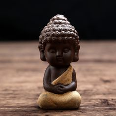 These Small Buddha Figurines are an adorable must-have for your home. Whether you purchase one figurine or all four, they'll add character to any room. Each Buddha figurine is wearing a different colo