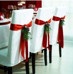 slip covered dining chairs with Christmas decorations and bows