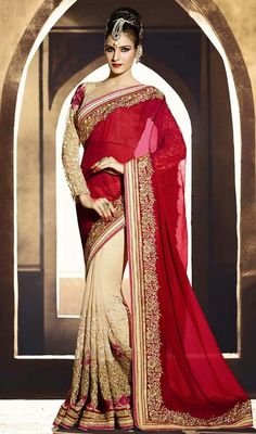 Make your own fashion statement with this crimson and cream color georgette shimmer half n half sari. The lace and resham work appears to be like chic and fantastic for any occasion. #designerhalfnhalfsari #embroideredhalfnhalfsari #floralworksarees