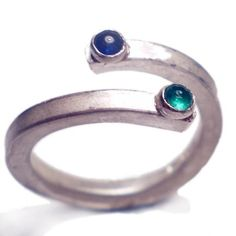 You and Me Ring sapphire and emerald by Catherine Marche