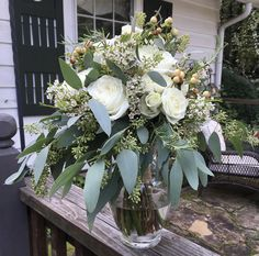 White garden roses, spray roses and blush berries, seeded euc. bridal bouquet by Cleveland Florist