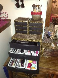 Here is an idea on how to decorate those Sterilite brand plastic drawer units. I used leopard duct tape, flat black spray paint to the inside of the drawers and fuzzy brown fabric and hot glue on top. Perfect for makeup storage and other girly stuff in rather than a bland white and clear unit. It was a fun DIY project for me!
