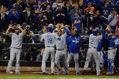 Crown Royal: Kansas City Royals rally again to win World Series | WORLD SERIES | -   NEW YORK, NY - NOVEMBER 01: Ben Zobrist #18 of the Kansas City Royals celebrates with his teammates after scoring a run off of a three run RBI double hit by Lorenzo Cain #6 to also scoring Alcides Escobar #2 and Paulo Orlando #16 in the twelfth inning against Bartolo Colon #40 of the New York Mets during Game Five of the 2015 World Series at Citi Field on November 1, 2015 in the Flushing neighborhood of the…