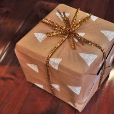 Add a personal touch to gifts with easy stamped gift wrap - all you need is a potato and some paint!