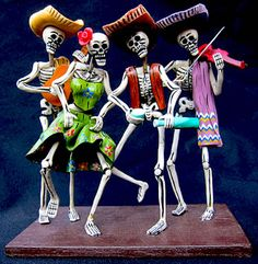 4 skeletons partying with their ancestors