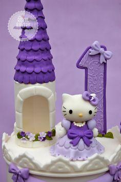 purple hello kitty cake for little girl's birthday
