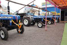 न्यू हॉलैंड ट्रैक्टर खरीदने का सोच रहे है अपने पसंदीदा ट्रैक्टर मॉडल की सूची,ऑन-रोड कीमत और ट्रैक्टर से जुडी सभी जानकारी मिलेगी यहाँ - #NewHolland #TractorBrand #TractorPrice #KhetiGaadi New Holland Tractor, Tractors, Model, Scale Model, Models, Template, Pattern, Mockup