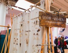 Great backdrop structure to highlight mobiles and create visual interest. Adds a little more than your average photo backdrop stand. Handmade sign is also a nice touch! #RenegadeCraftFair #RenegadeNY