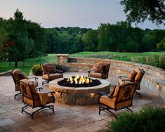 An outdoor living space in Leawood, Kan., features a round fire pit on a paver patio. The fire pit and patio use Belgard's Mega Lafitt pavers and stones, which have the texture and look of cut flagstone. Fire Pit Seating, Fire Pit Area, Diy Fire Pit, Fire Pit Backyard, Seating Areas, Pergola Patio, Backyard Patio, Backyard Landscaping, Modern Backyard