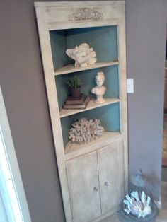 Love this corner cabinet with shelves!