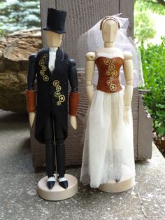 Steampunk wedding cake toppers by *Hiddendemon-666 on deviantART...these can be DIY using wooden art dolls and Barbie clothes or, if your crafty enough, you can DIY on the clothes too!