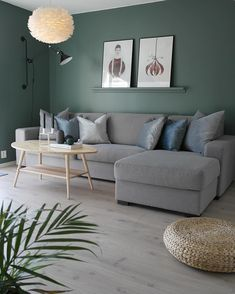 Bring the nature inside by using green as your main colour in combination with wooden materials and the classic Eos feather lamp. Photo credit: @stinegskjervegge  Eos, VITA copenhagen, lampshade, lamp, lighting, hygge, cosy, light, design, nordic home, nordic design, danish design, scandinavian design, Denmark, Scandinavia, Scandinavian Home, Urban Living, Nordic Living, minimalism, Nordic inspiration, Nordic minimalism, home decor, interior, Soren Ravn Christensen