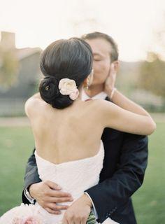 Fresh Flowers in Bridal Updo | photography by http://www.carolinetran.net/
