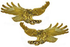 #94-394R/L- Screaming eagles emblem set includes two eagles with a 4.5 inch wingspread that are landing from the right and the other from the left. All emblems are metal plates with double-sided adhesive foam backs.