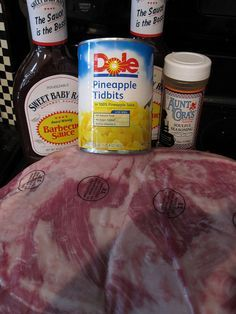 BBQ Pineapple Pulled Pork  Ingredients: - one 4 - 6 pound pork shoulder - all purpose seasoning (I love Aunt Cora's Soulful Seasoning) - one bottle of barbecue sauce (I love Sweet Baby Ray's) - one 15 ounce can of diced pineapples, undrained