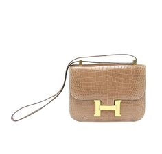 b5a1c2b54190 Hermes Constance 23 in Light Beige. Made from exotic crocodile skin. This  bag is