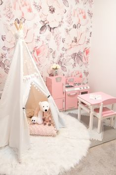 Glamorous pink playroom with white lace teepee, pink play kitchen and floral wallpaper - Floral wallpaper nursery ideas - Playroom ideas for girls