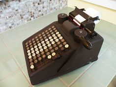Burroughs adding machine $50; http://www.etsy.com/listing/85893944/burroughs-adding-machine-vintage-office?ref=sr_gallery_23&sref=&ga_search_submit=&ga_search_query=vintage+office&ga_view_type=gallery&ga_ship_to=US&ga_page=3&ga_search_type=vintage&ga_facet=vintage