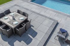 This slab is timeless and will bring modernity to your exterior decor! Available in 5 beautiful colors, the Proma Quadra slab is the perfect choice for a clean and modern look! Swimming Pool Designs, Swimming Pools, Patio Slabs, Modern Backyard, Outdoor Living, Outdoor Decor, Charcoal, House Ideas, Surface