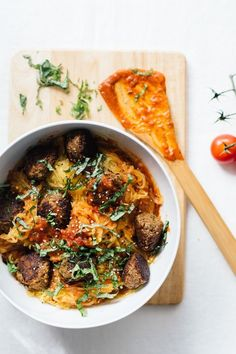 Spaghetti Squash and Chickpea Meatballs is a how to guide on making simple and delicious gluten free and vegan meatballs with squash noodles.