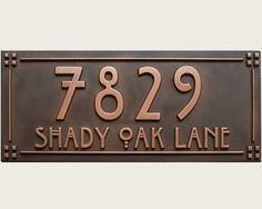 Cute idea to incorporate the street name - doesnt have to be from this site though. But like the copper colors and craftsman font.