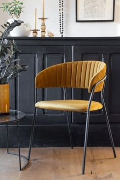 This curvy velvet dining chair in golden ochre with a matt black frame is from Rockett St George. Wooden Dining Chairs, Dining Room Furniture, Table And Chairs, Home Furniture, Yellow Home Decor, Dinner Table, Contemporary Design, Kitchen Dining, Upholstery