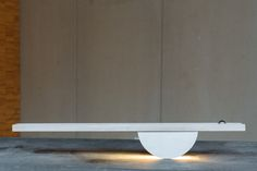A balance lamp that turns on when you lift one side, causing a metal ball to roll over to the other side and turn on the light. Made by Andreea Tecusan.