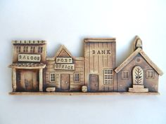 Ceramic Old western town wall hanging, Ceramic house, Pottery house, Clay  houses,house ornament, handmade ceramics and pottery by potteryhearts on Etsy https://www.etsy.com/listing/194335231/ceramic-old-western-town-wall-hanging