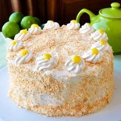 Coconut Lime Marshmallow Cake. A fantastic combination of flavours and textures including a light lime sponge cake, a tangy lime curd, fluffy marshmallow frosting and a generous coating of toasted coconut.