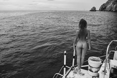Naked girl standing on boat by Stefan Rappo