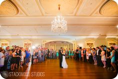 I love how the guests are surrounding the bride and groom dancing in Lovett Hall!