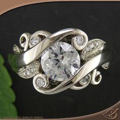 Amazing! Wide and Swirly engagement ring