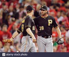 Download this stock image: Pittsburgh Pirates pitcher Jason Grilli (39) celebrates with Justin Morneau (66) after defeating the Cincinnati Reds 4-1 in their MLB National League baseball game at Great American Ball Park in Cincinnati, Ohio, September 27, 2013. REUTERS/John Sommers II (UNITED STATES - Tags: SPORT BASEBALL) - 2CY239B from Alamy's library of millions of high resolution stock photos, illustrations and vectors. Baseball Games, Sports Baseball, National League, Pittsburgh Pirates, Cincinnati Reds, Ohio, Vectors, September