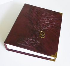 Wonderful leather photo with painted in front and bronze intertwined hearts Leather Art, Leather Gifts, Burgundy Walls, Burgundy Suit, Burgundy Shoes, Wedding Photo Albums, Wedding Photos, Disney Princess Decorations, Leather Folder