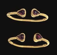 A pair of Greek gold and garnet bracelets circa century B. The solid-cast penannular hoops round in section, four sets of ribbed bands along the length, terminating in two heart-shaped garnets, the bezels with scalloped borders Roman Jewelry, Greek Jewelry, Ethnic Jewelry, Jewelry Art, Gold Jewelry, Jewlery, Bracelet Antique, Antique Jewelry, Vintage Jewelry
