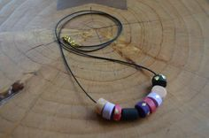 Accessorize with this beautiful long necklace made w/ polymer clay beads, 24k gold leaf, on waxed cord.